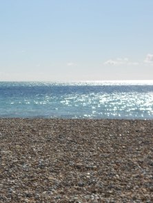Shingle foreground and light sparkling on the water. Strong horizontal lines, you will see several variations on this.